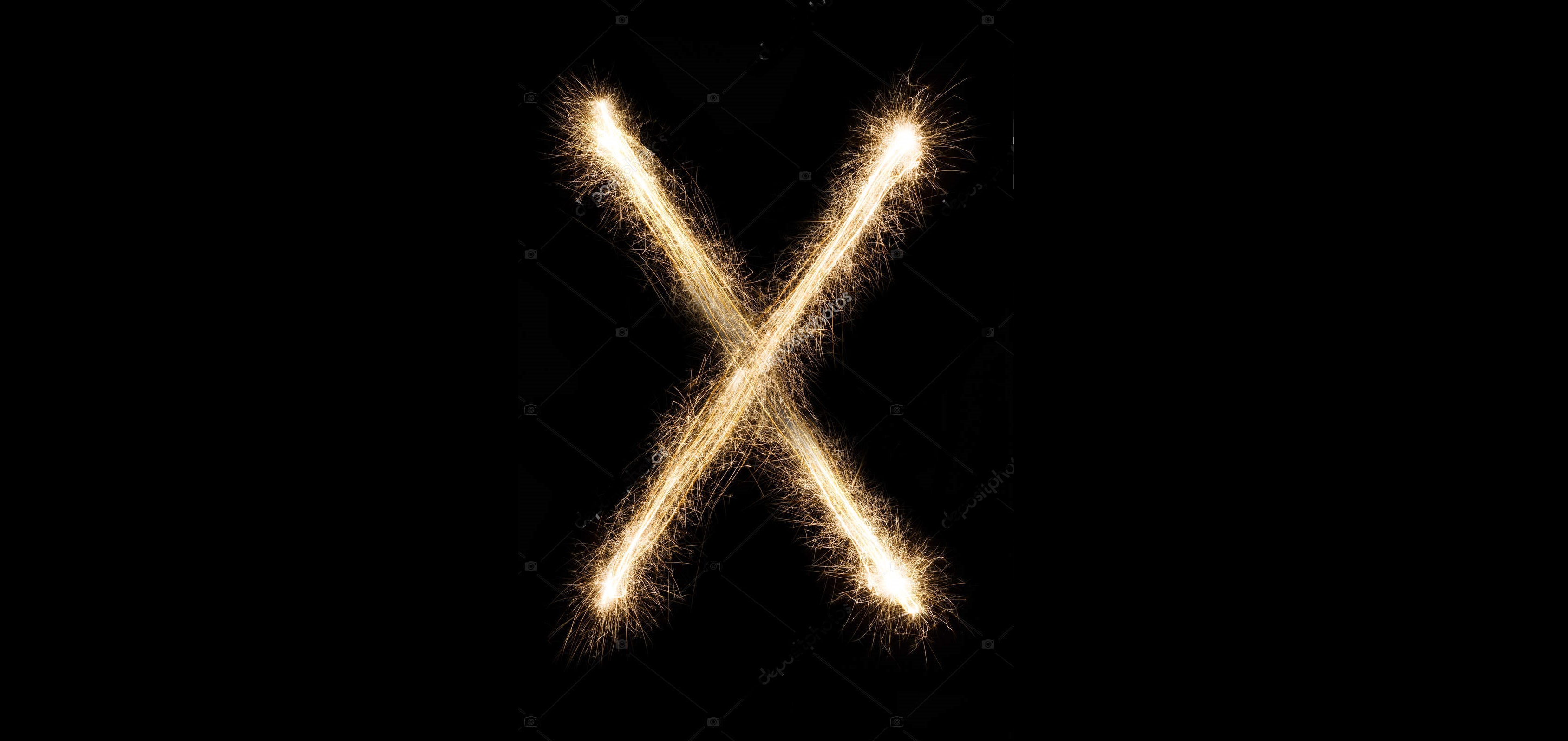 English Letter X from sparklers alphabet on black background.